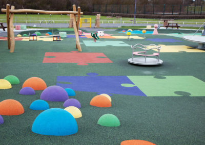 Impact-absorbing playground surfacing